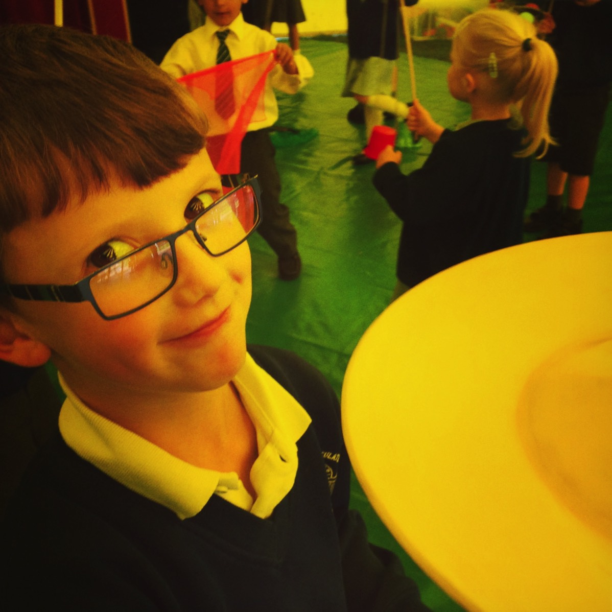 Plate spinning at a circus skills workshop for schools